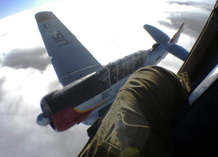 In a Cessna 182RG, shooting a T6 Texan