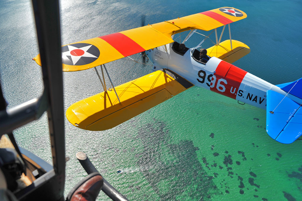 Shooting an N2S Stearman from an R44 helicopter