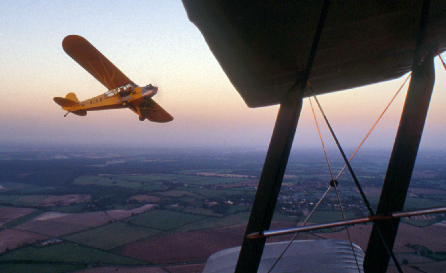 View of Jon in a Piper Super Cub, shooting a DH Tiger Moth. Photo by Brian Peart