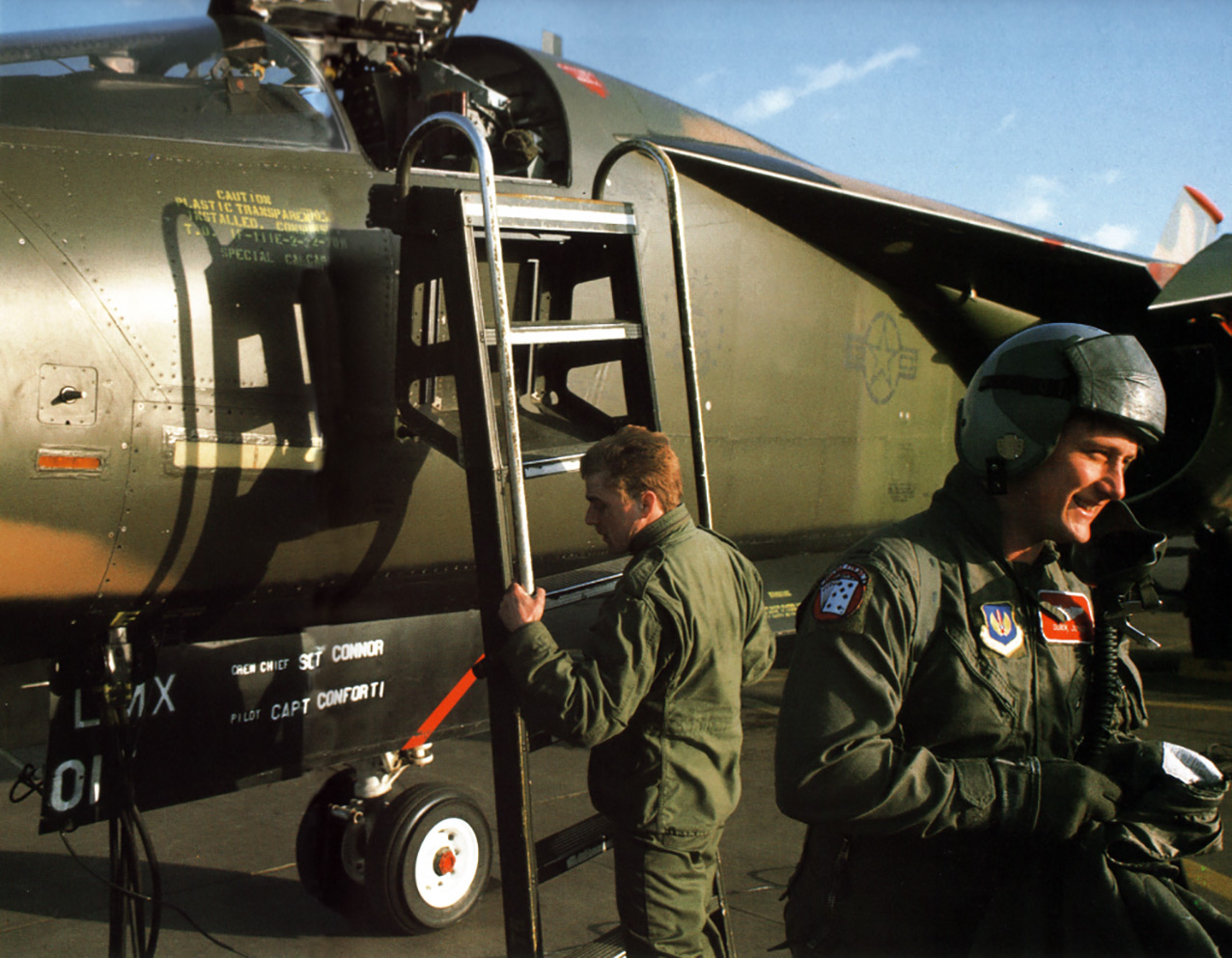 Captain Derek Jones leaves his F-111E after a mission in their F-111E at RAF Upper Heyford, 1990