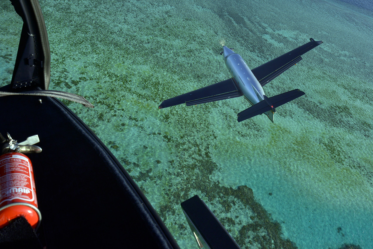 Shooting a PC12 over the Great Barrier Reef, Qld. Shot from an AS350.