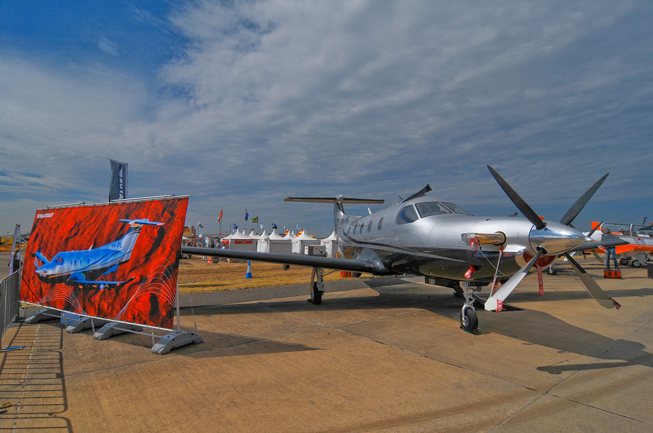 Large banner of a PC12 (VH-PIL) and the aircraft, at the Avalon International Airshow