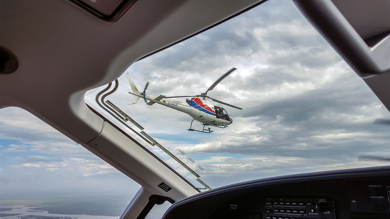 Jon in an AS350 shooting a PC12 over Iceland. Photo by Reykjavik Helicopters