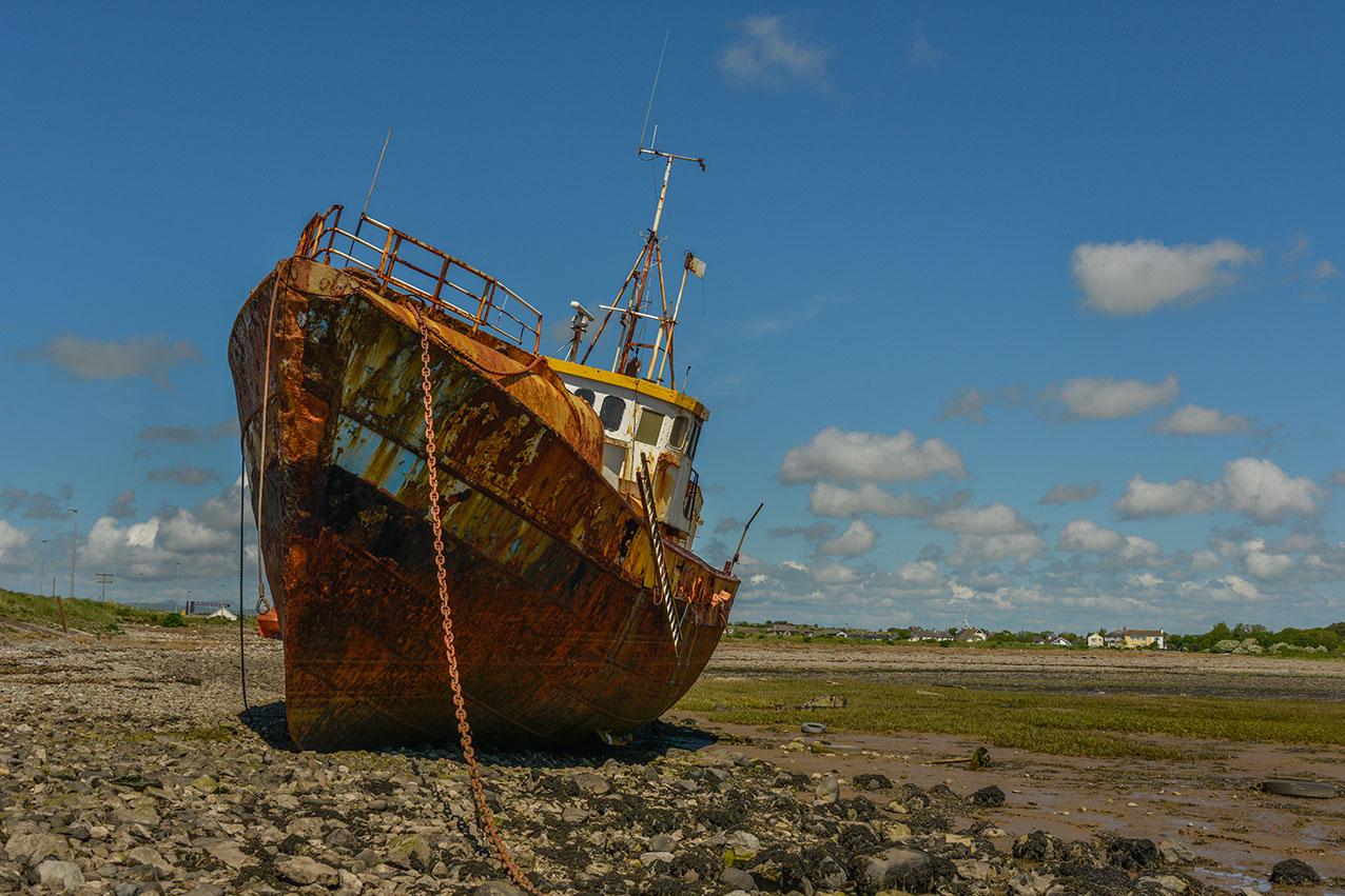 Rusting vessel near Barrow-in-Furness, Cumbria UK