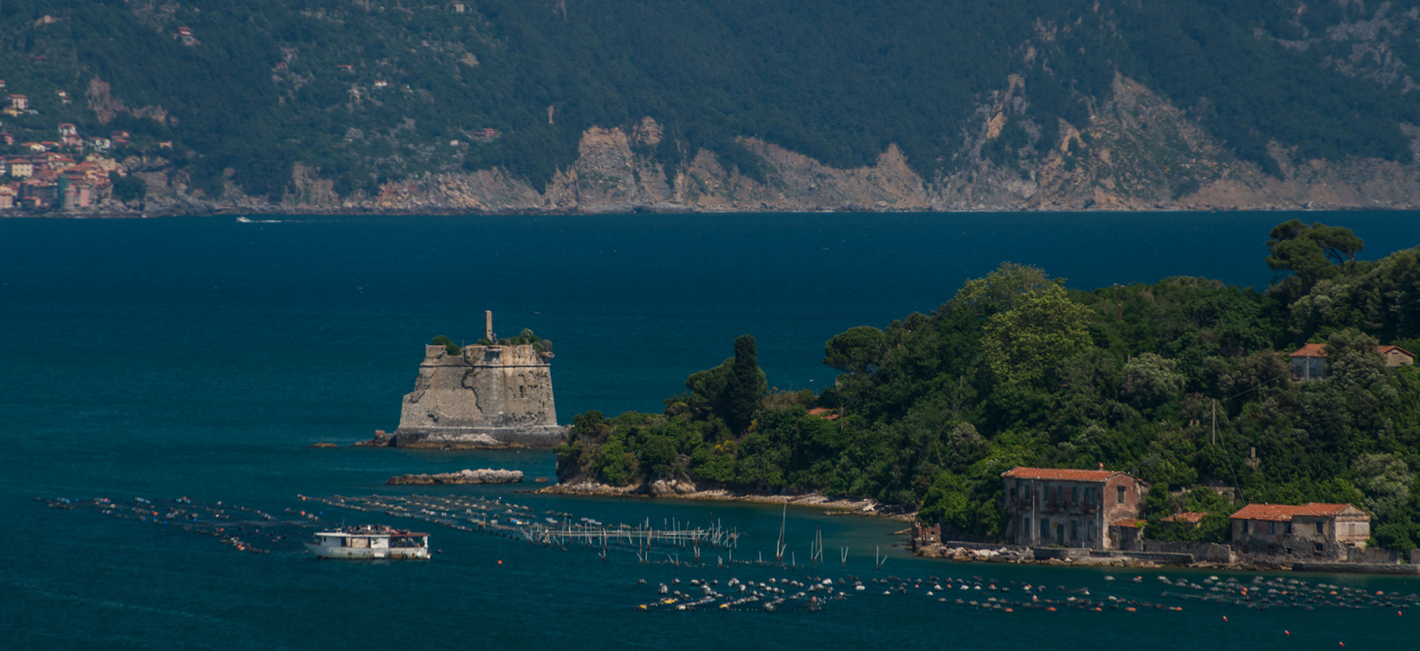 Medieval fortification at Porto Venere. Tellaro is in the background.