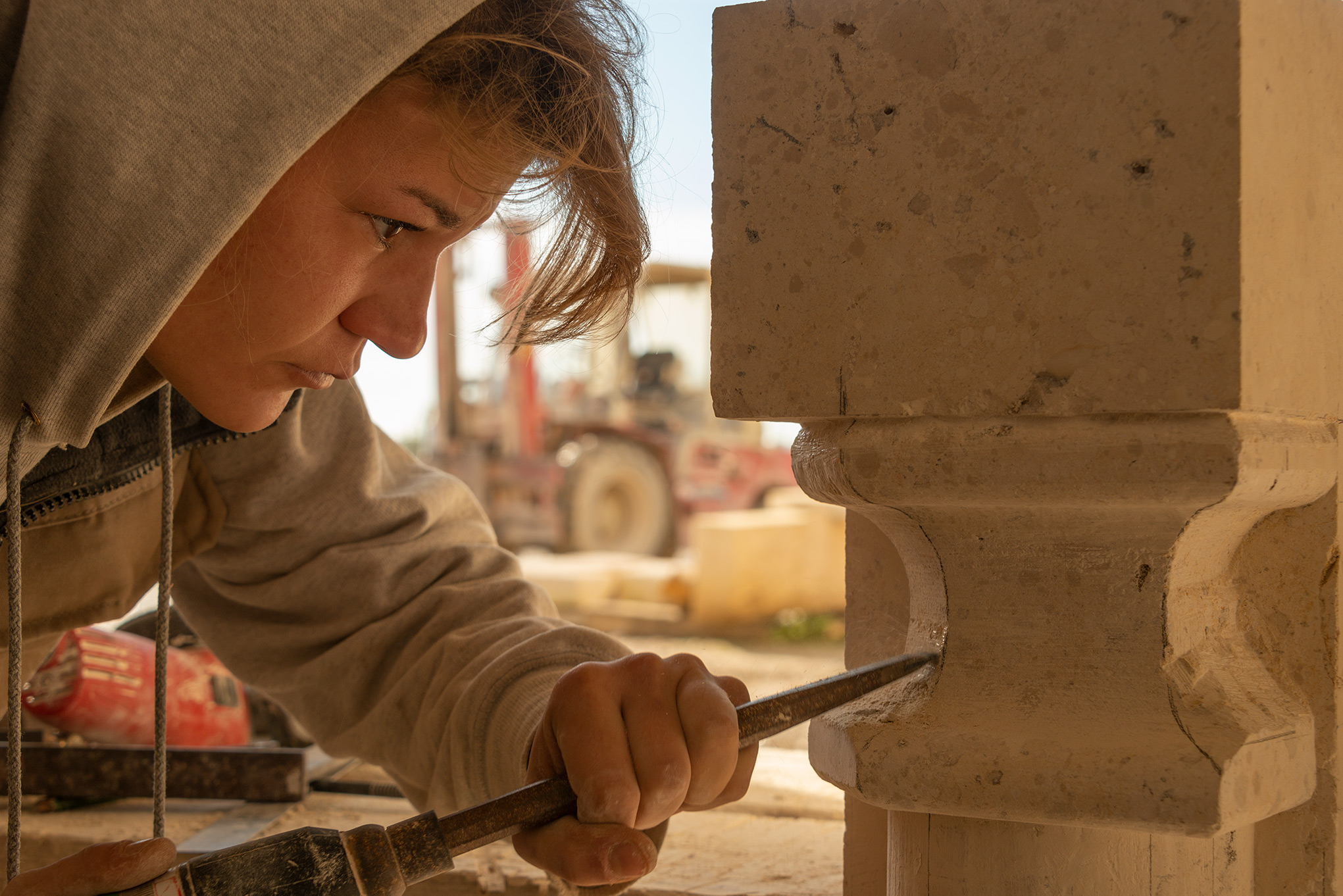 Trainee stone mason at work - France