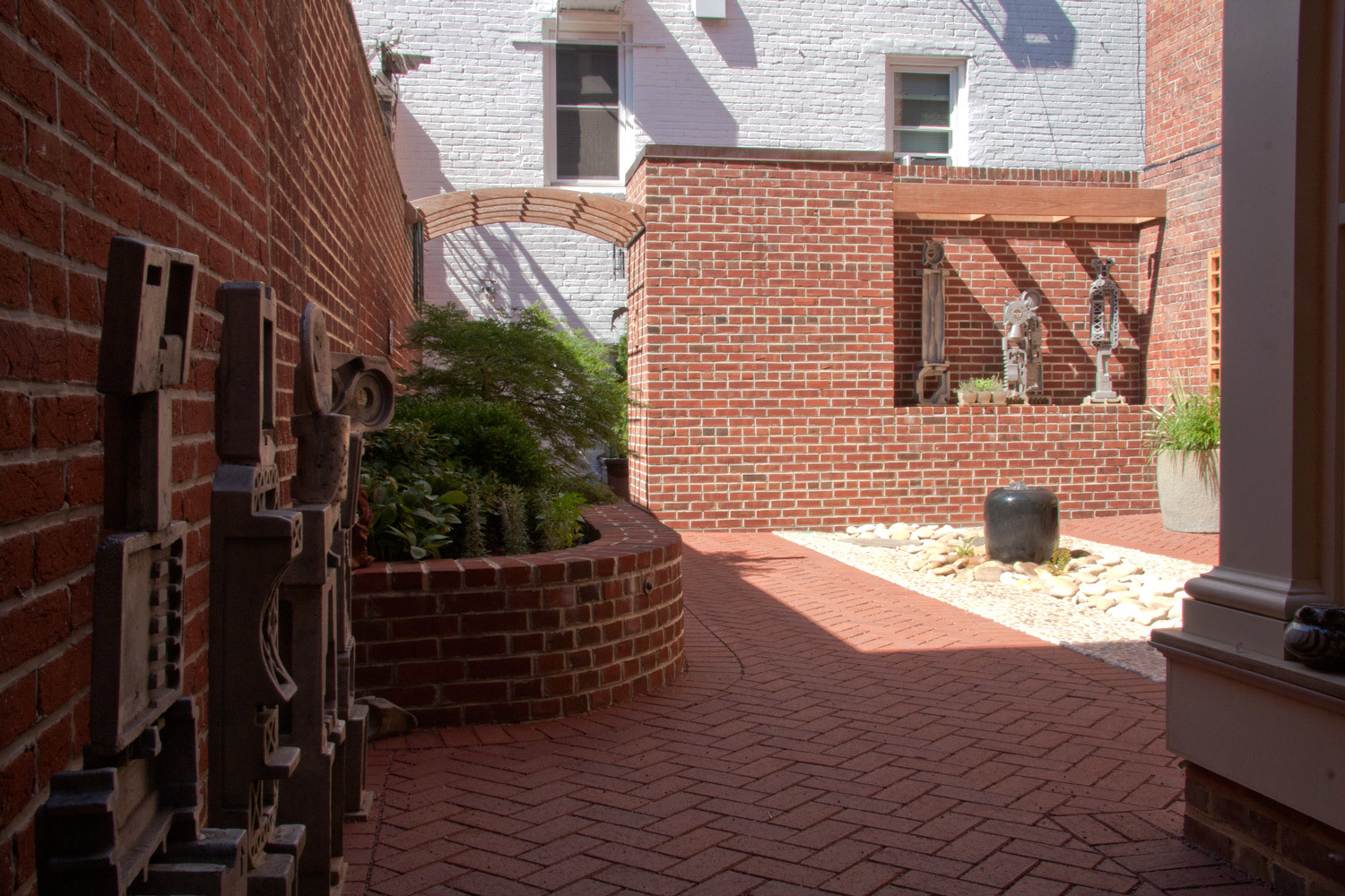 Project Location:  Washington, DC (Logan Circle)  Completion:  Winter 2010  General Contractor:  Redux Garden & Home  Primary Material Palette:  permeable clay pavers, black granite (fountain), antique granite (planters), ipe, river rock, stainless steel, aluminum sculptures, western red cedar trellis  Photo By:  George Brown