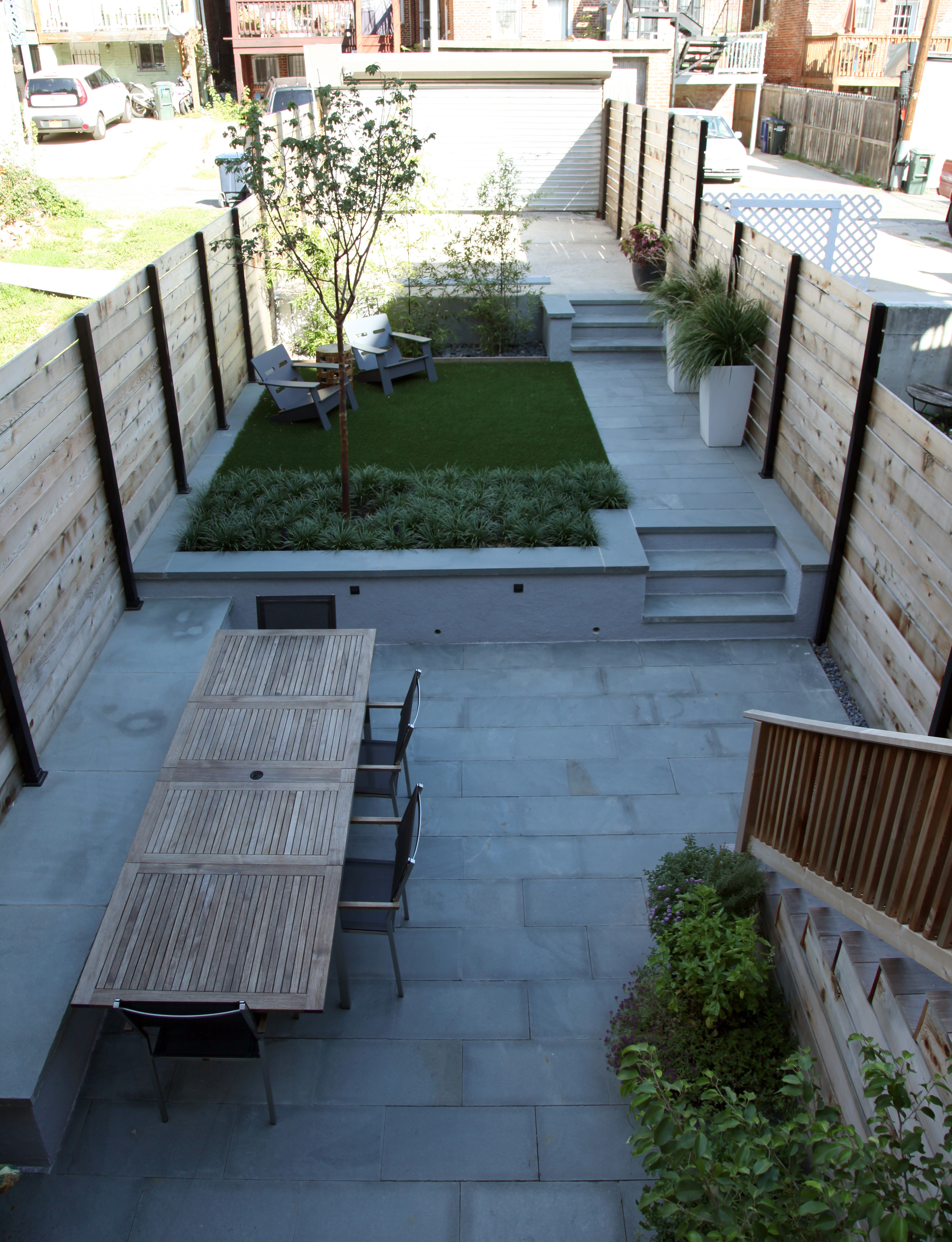 Project Location: Washington, DC (Columbia Heights)  Completion: Spring 2015  General Contractor: Redux Garden & Home  Primary Material Palette: thermal finish select blue bluestone, cedar, stucco concrete, synthetic turf, ipe  Photos By: Moody Landscape Architecture