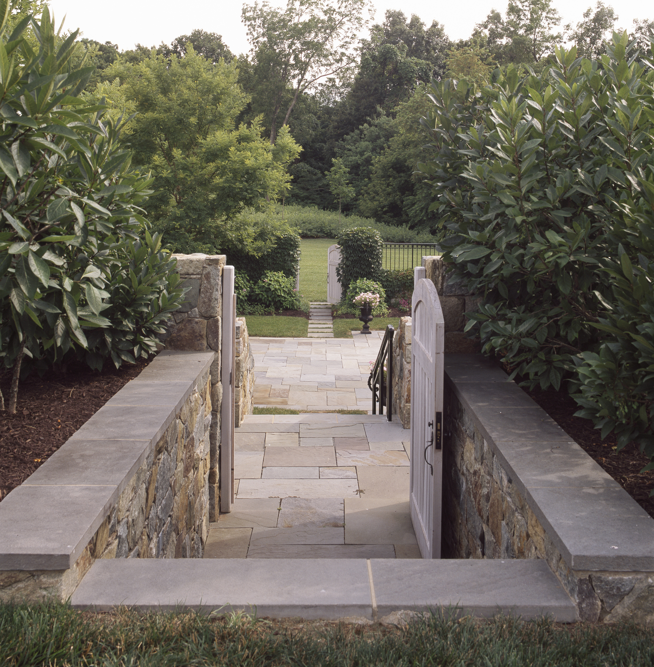 Project Location: Howard County, Maryland  Completion: 2006  General Contractor: Horizon Builders, Chapel Valley  Project Architect: Muse Architects  Primary Material Palette: fieldstone, bluestone  Photos By: Erik Kvalsvik  Awards: Merit Award, American Society of Landscape Architects Maryland Chapter, 2006 Outstanding Landscaping Award, Washington Spaces, 2008