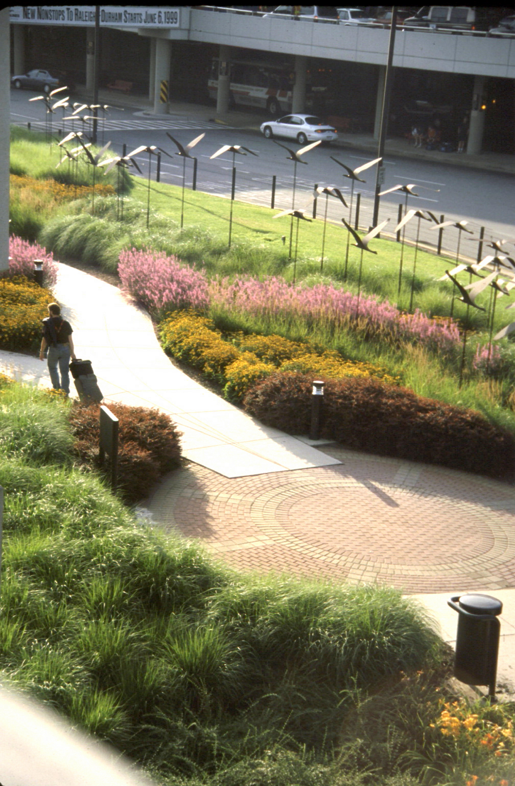 Project Location: Linthicum, MD  Completion: 1989  Primary Material Palette: corten steel, concrete, perennials  Photos By: Graham Landscape Architecture  Awards: Merit Award, American Society of Landscape Architects Maryland Chapter, 1993 Landscape Award, inform Magazine, 1995