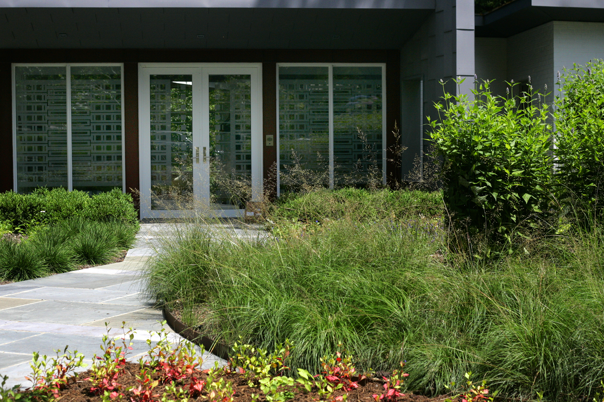 Project Location: Washington, DC (Forest Hills)  Completion: 2010  Landscape Contractors: Quarry Aquatics, Evergro Landscaping  Project Architect: Cunningham Quill  Primary Material Palette: bluestone  Photos By: Erica Thum