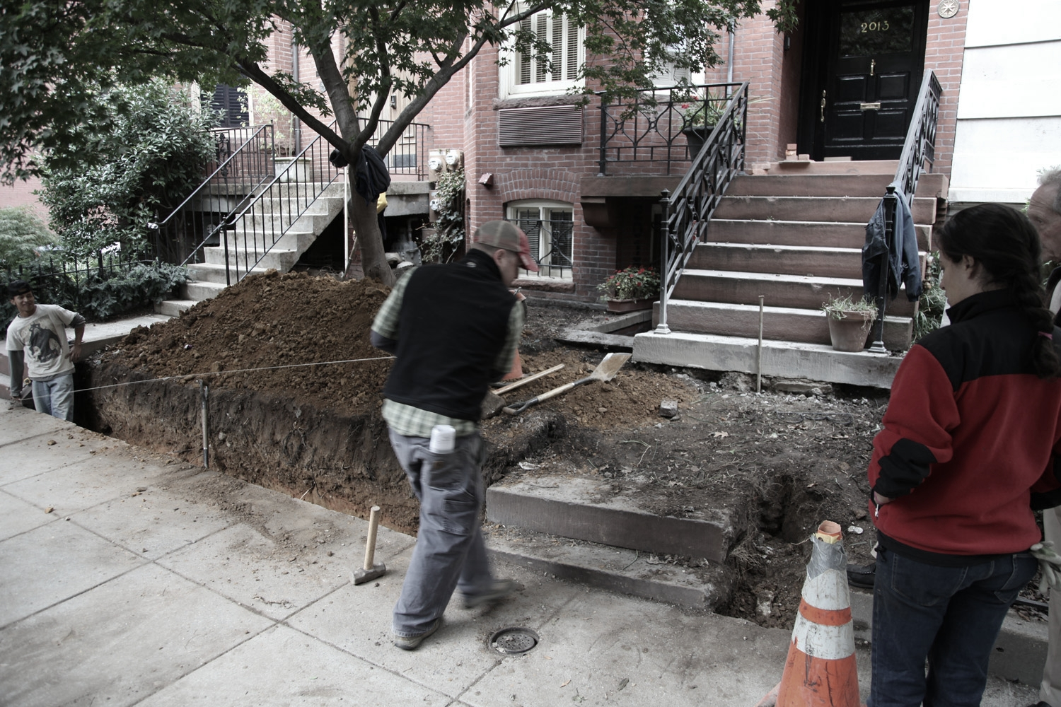 Front garden demolition and preparation for new brick retaining wall, new metal fence, new stone cheek walls, new custom handrail to match historic finials, and new stone step to match historic brownstone