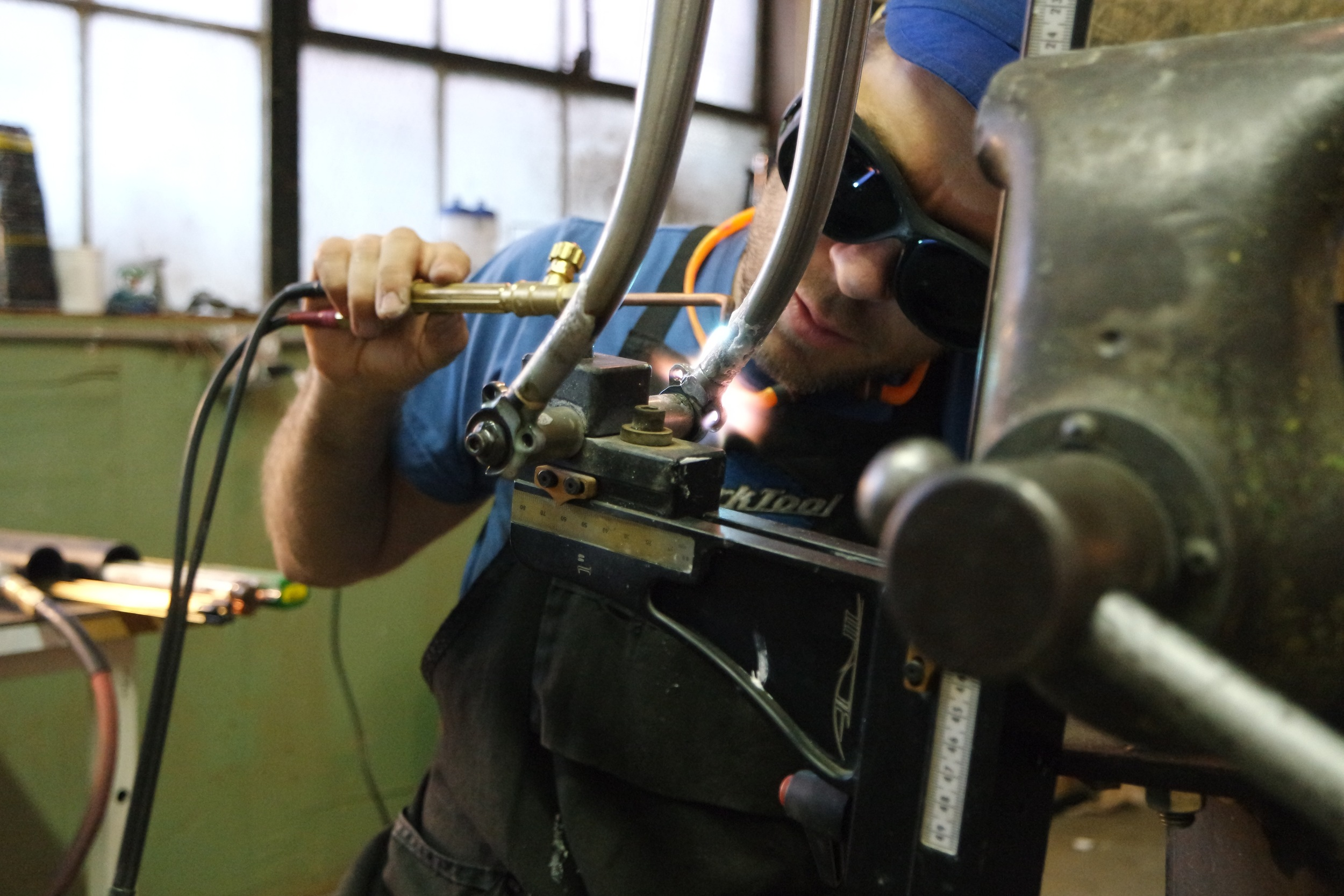 Yours truly in action, silver brazing plug-in dropouts to the fork blades.