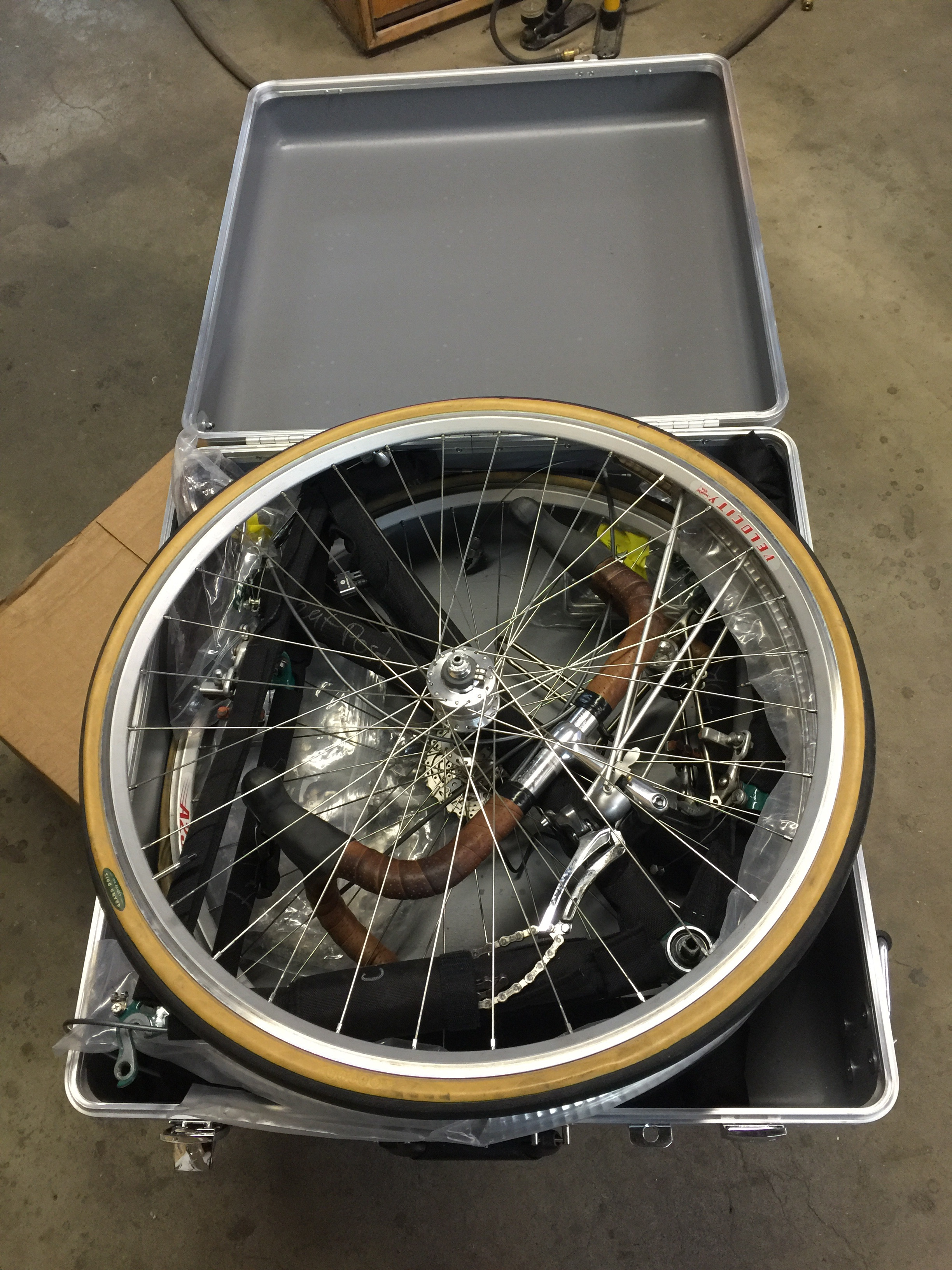 And lastly the rear wheel. It usually easier to insert the wheel into the lid of the case before closing it. It's kind of tight with with everything in there, but don't worry it'll fit.