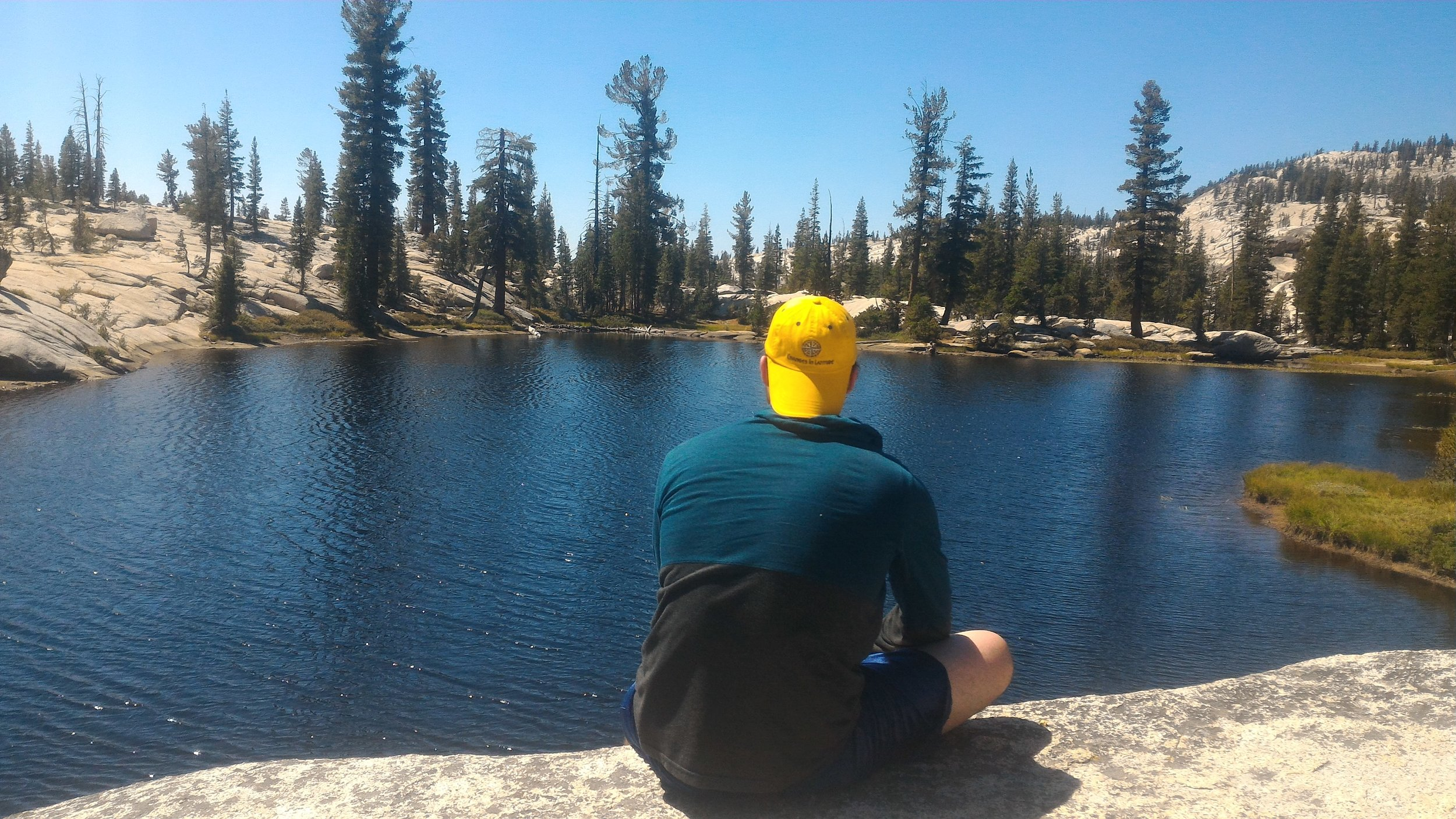 A local Changes in Latitude fan, Jonathan, taking in the view at Raisin Lake, Yosemite.