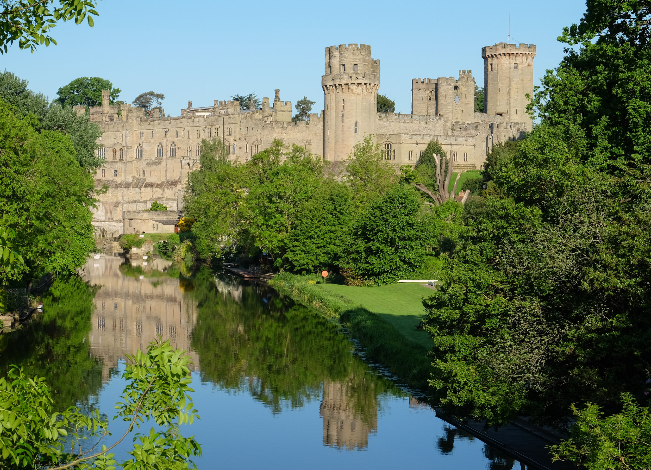 """"""" Warwick Castle """" by  DeFacto , licensed under CC BY-SA 4.0 ( https://creativecommons.org/licenses/by-sa/4.0/deed.en ). A medieval castle built in 1068 in Warwick, England."""