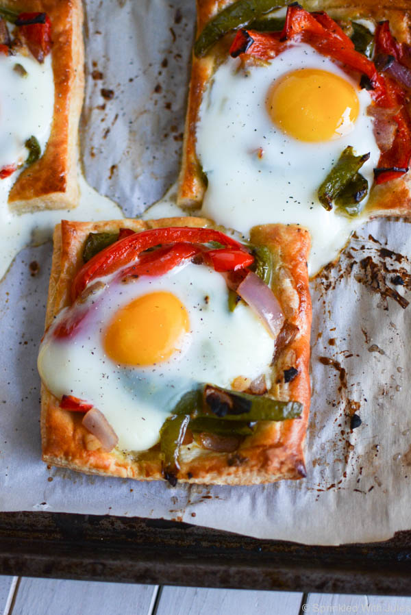 Roasted Vegetable and Egg Puff Pastry Tarts. Puff pastry with cream cheese and roasted veggies piled on, and topped with an egg.  So easy, yet so gourmet. / Sprinkled With Jules