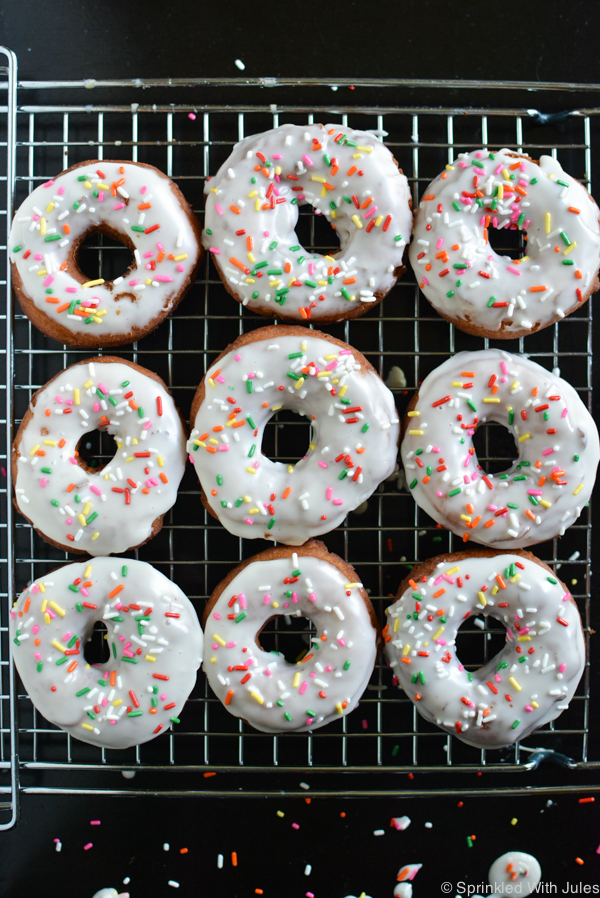traditional fried cake donuts with vanilla glaze and sprinkles