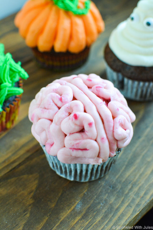 4 easy halloween cupcake ideas that anyone can try! monster, pumpkin, brain, and ghost tutorials.