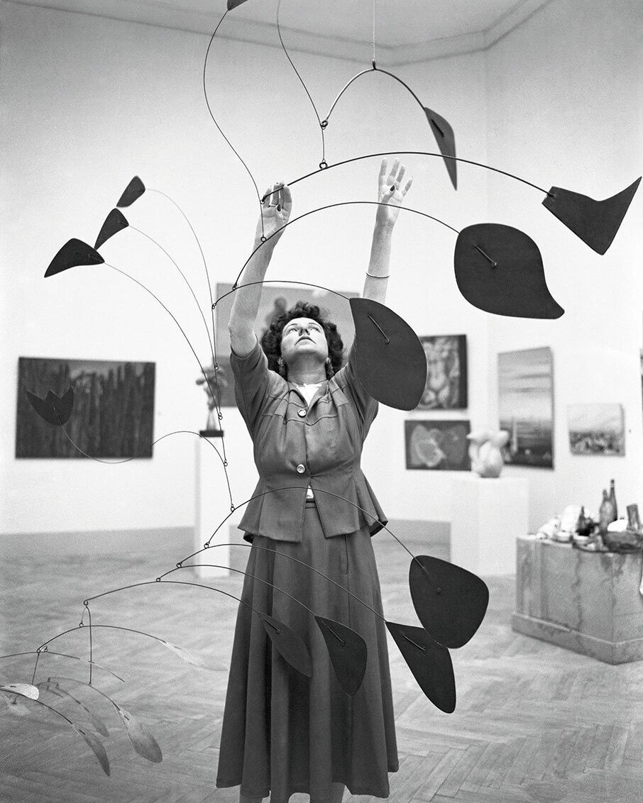 people-peggy-guggenheim-1948-calder-mobile-arc-of-petals.jpg