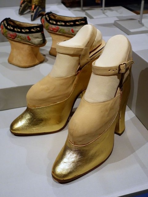 "A pair of ""trick"" platform shoes worn by Mae West in films to make her look taller, which also contributed to her unique walk."