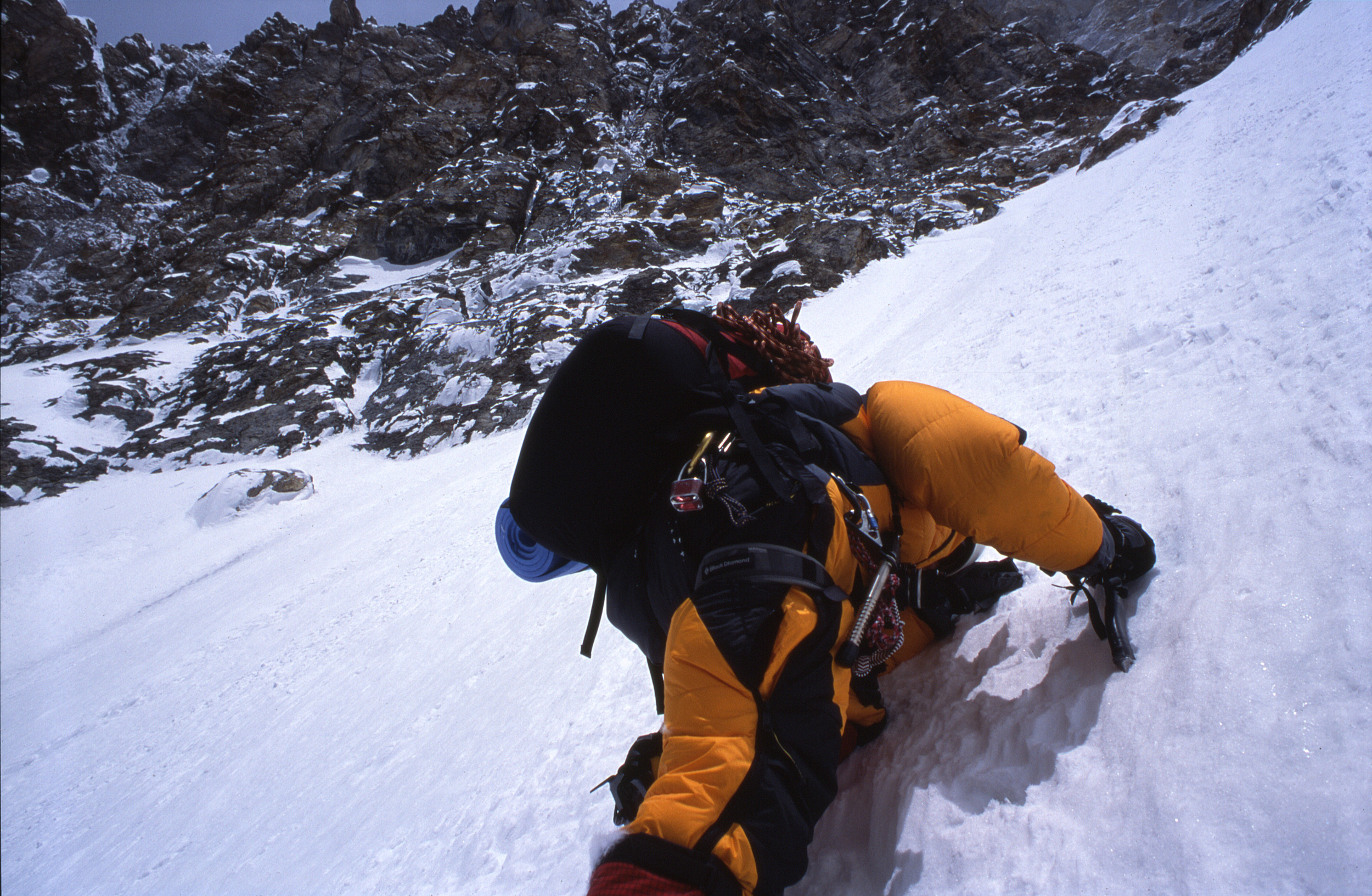 Climbing the initial, major couloir on the west face.