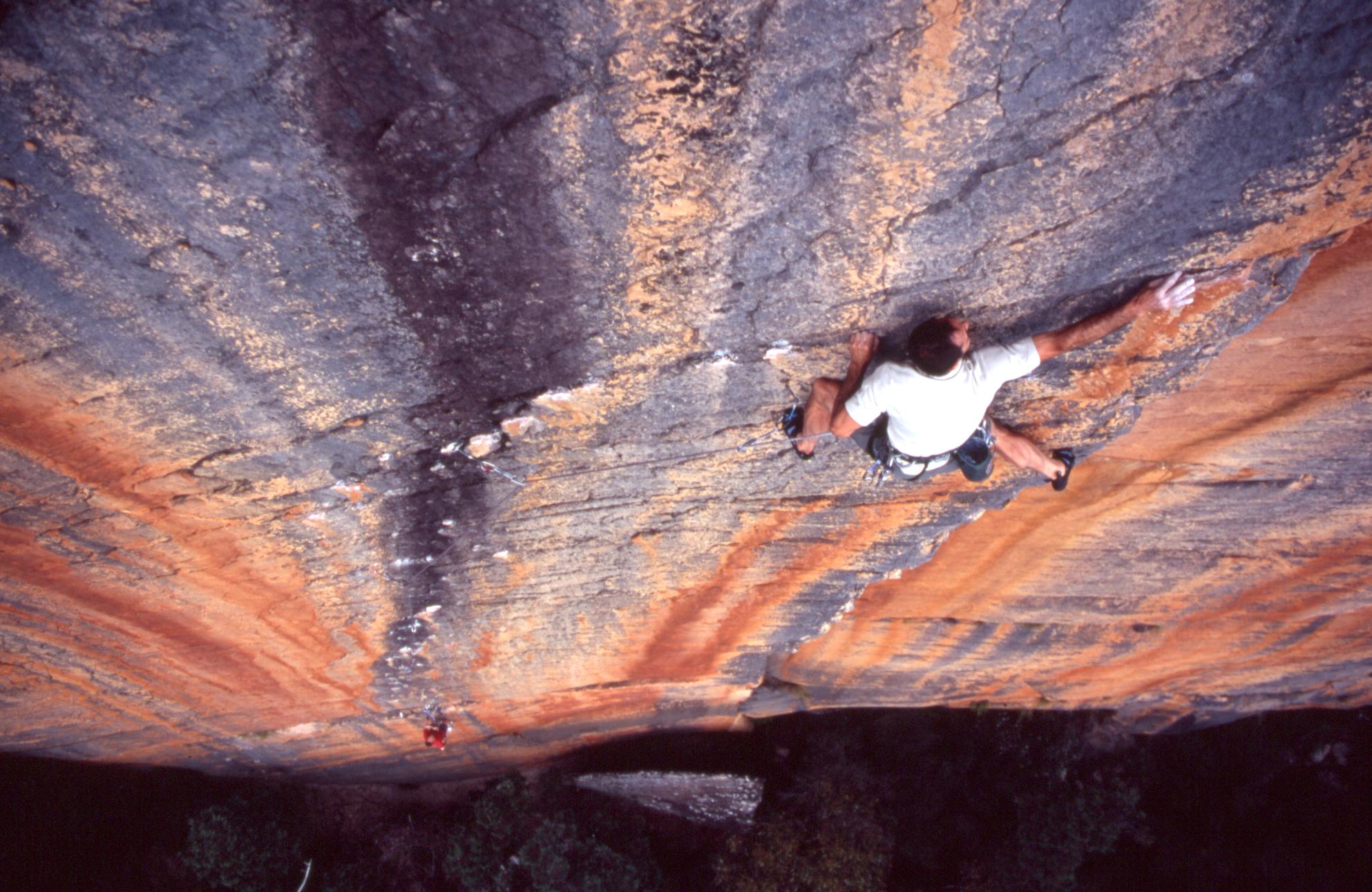 "Athol putting the finishing touches on ""Archimedes' Principle"" (25), Eureka Wall, 2004. Rob Lindblade on belay."
