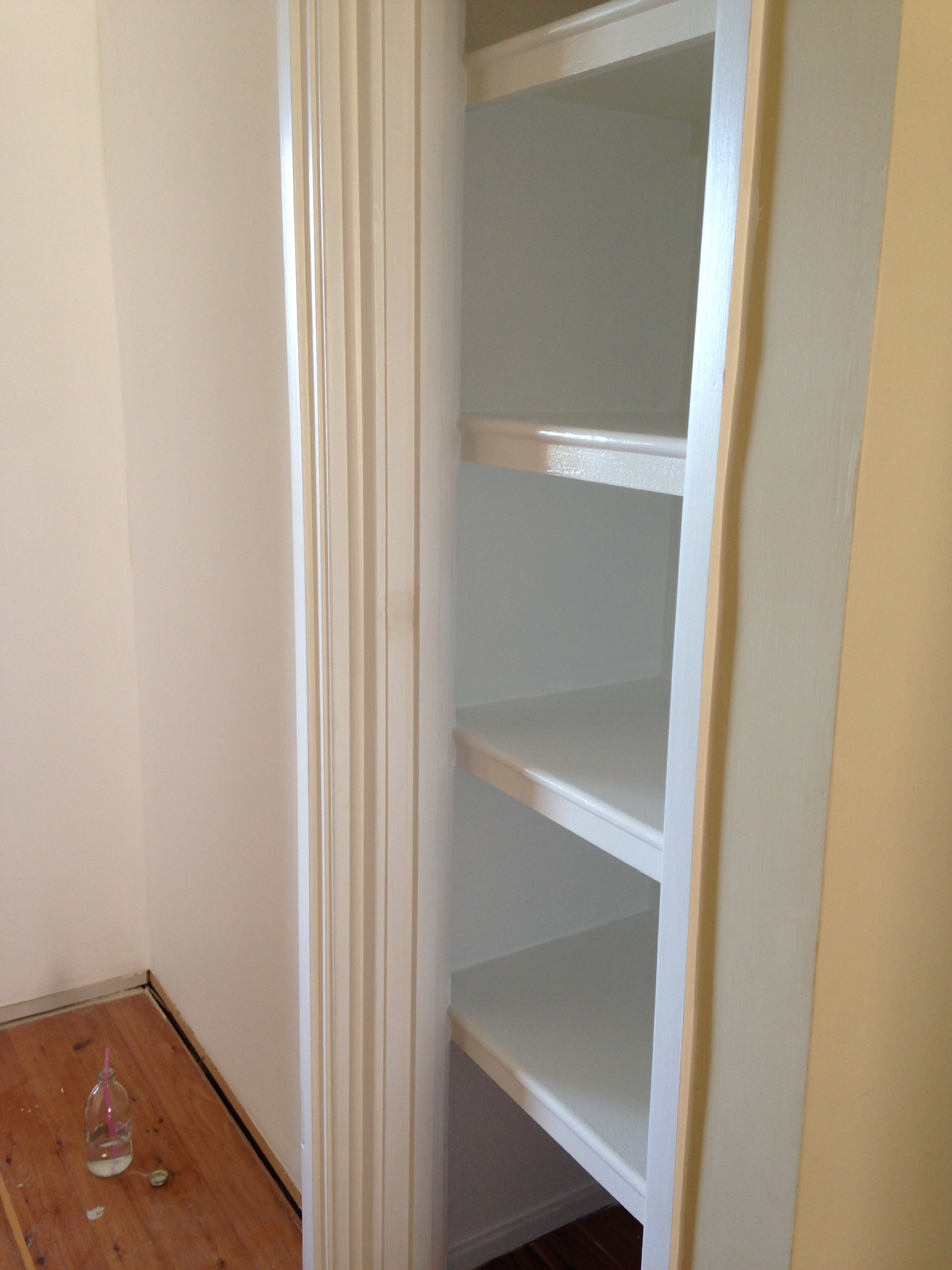 Hall cupboard in the process of being painted in Dulux Vivid White and a glimpse of Ashleigh's bedroom painted in Dulux Natural White