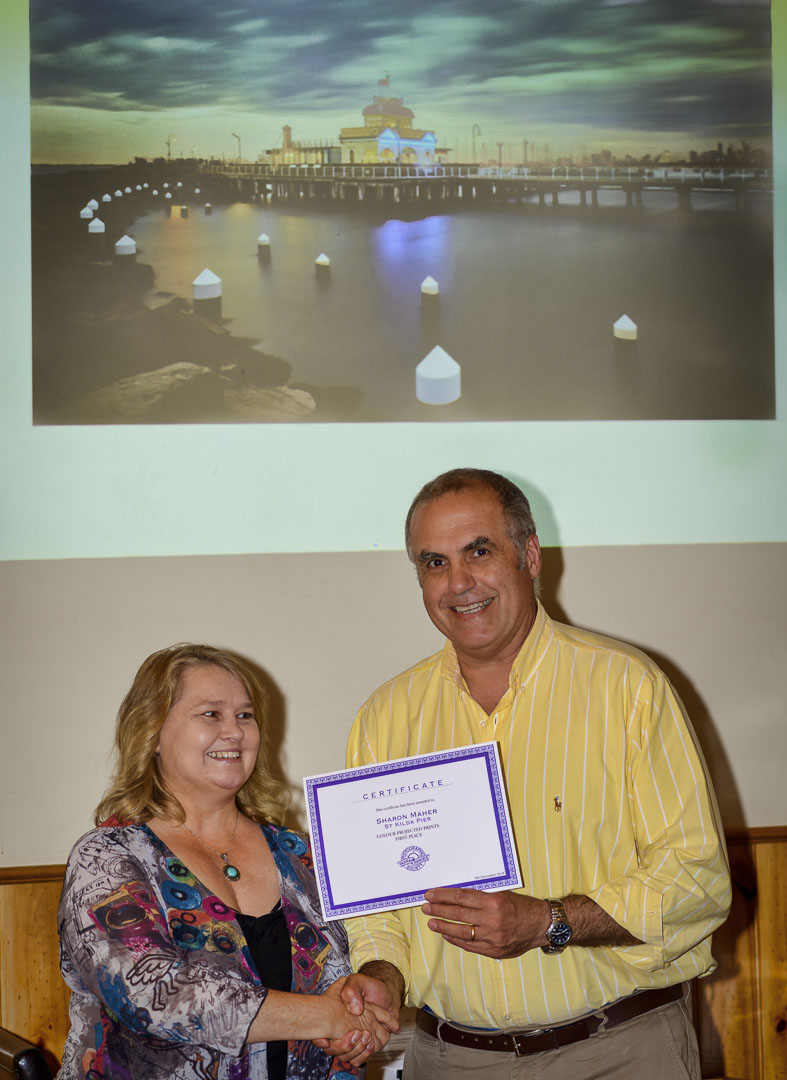 Sharon Maher collects her 1st Place certificate for the Colour Projected Image section.