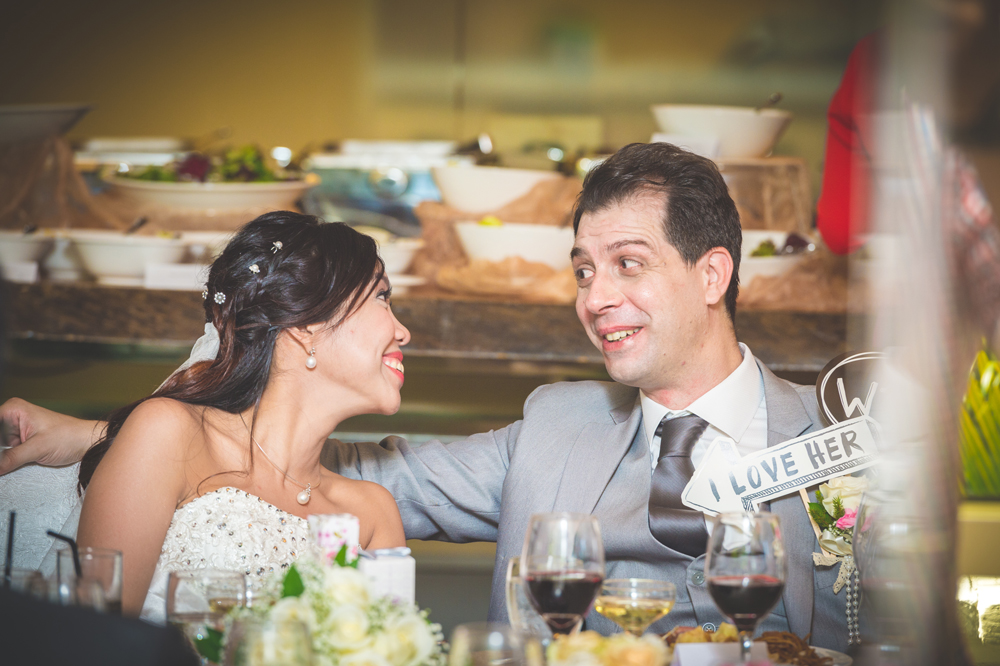 Lovely image of the couple taken during the wedding dinner, by our freelance photographers