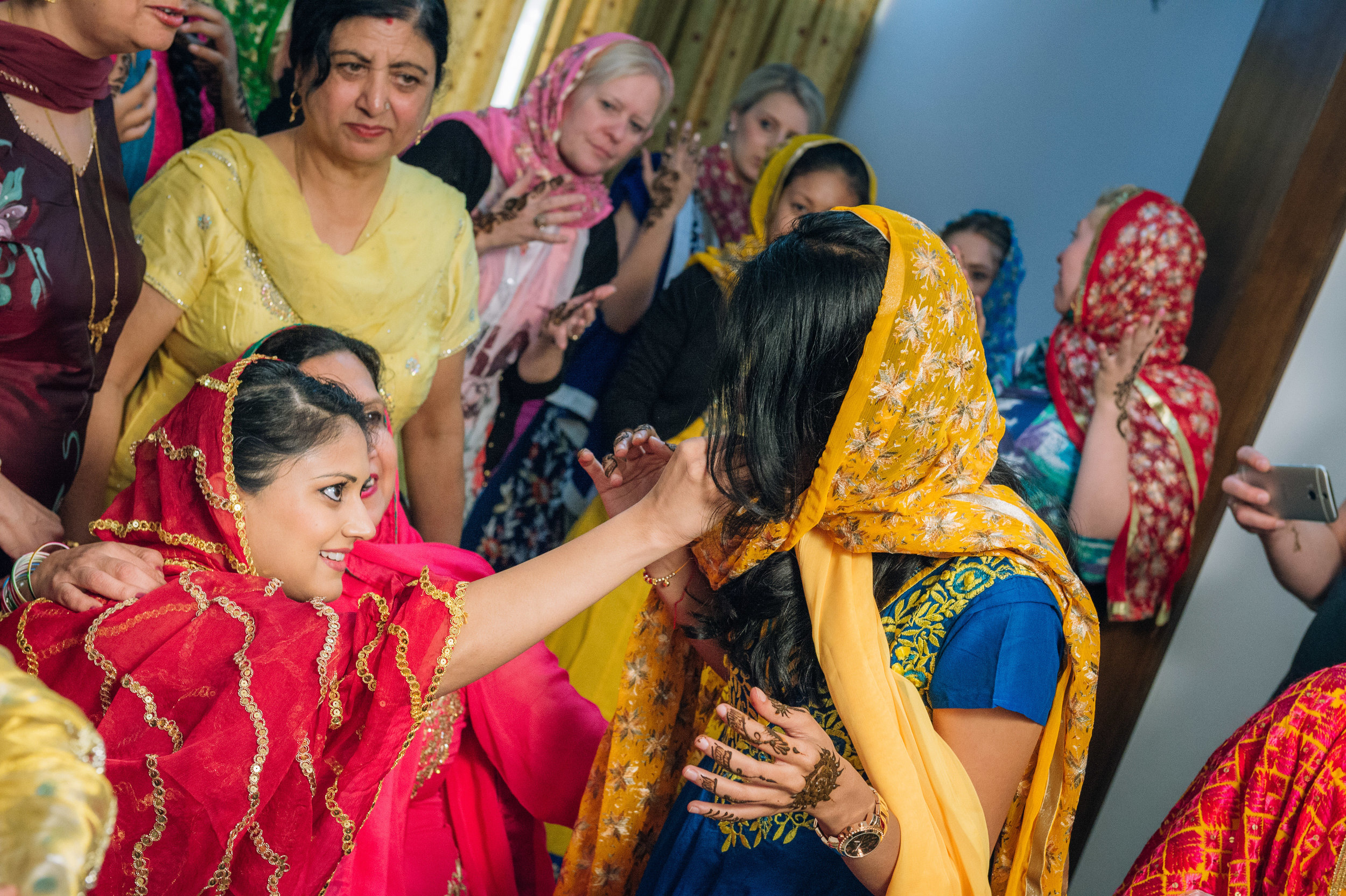 Honestly, I'm not sure what the bride was feeding this dear friend of hers but what I got to know is that the recipient of whatever the bride-to-be is feeding will be the next in line to get married. All the best Shalini!
