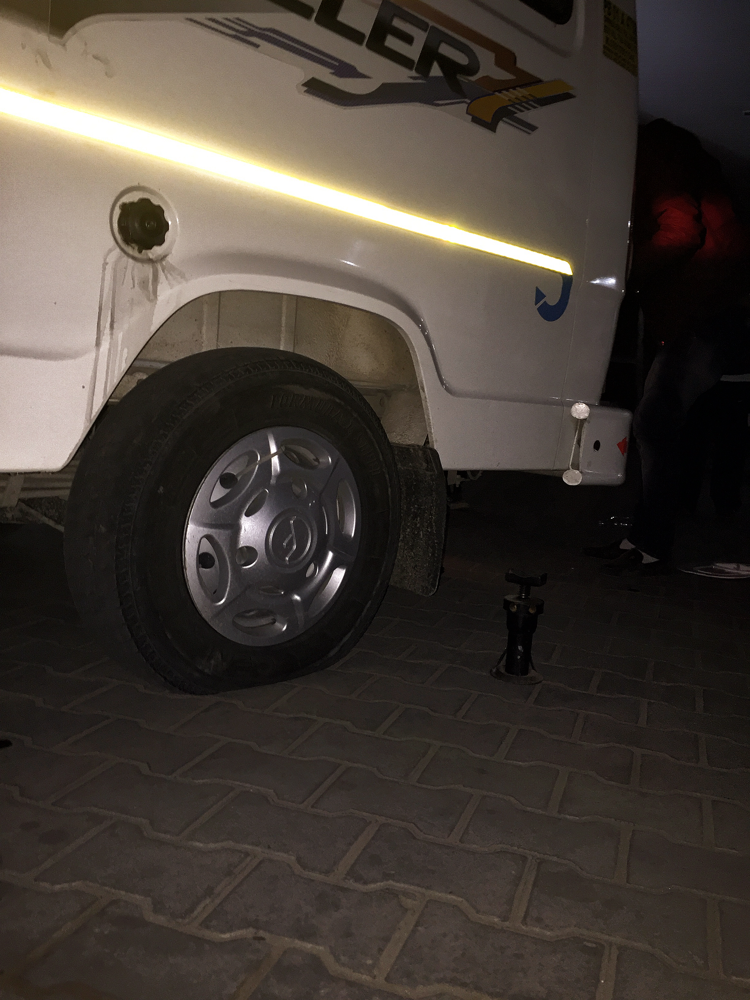 It took the driver about 40mins to change the flat tyre out. Most of us helped by shining our mobile phone lights so that he can see better.  (Image taken with iPhone 6+)