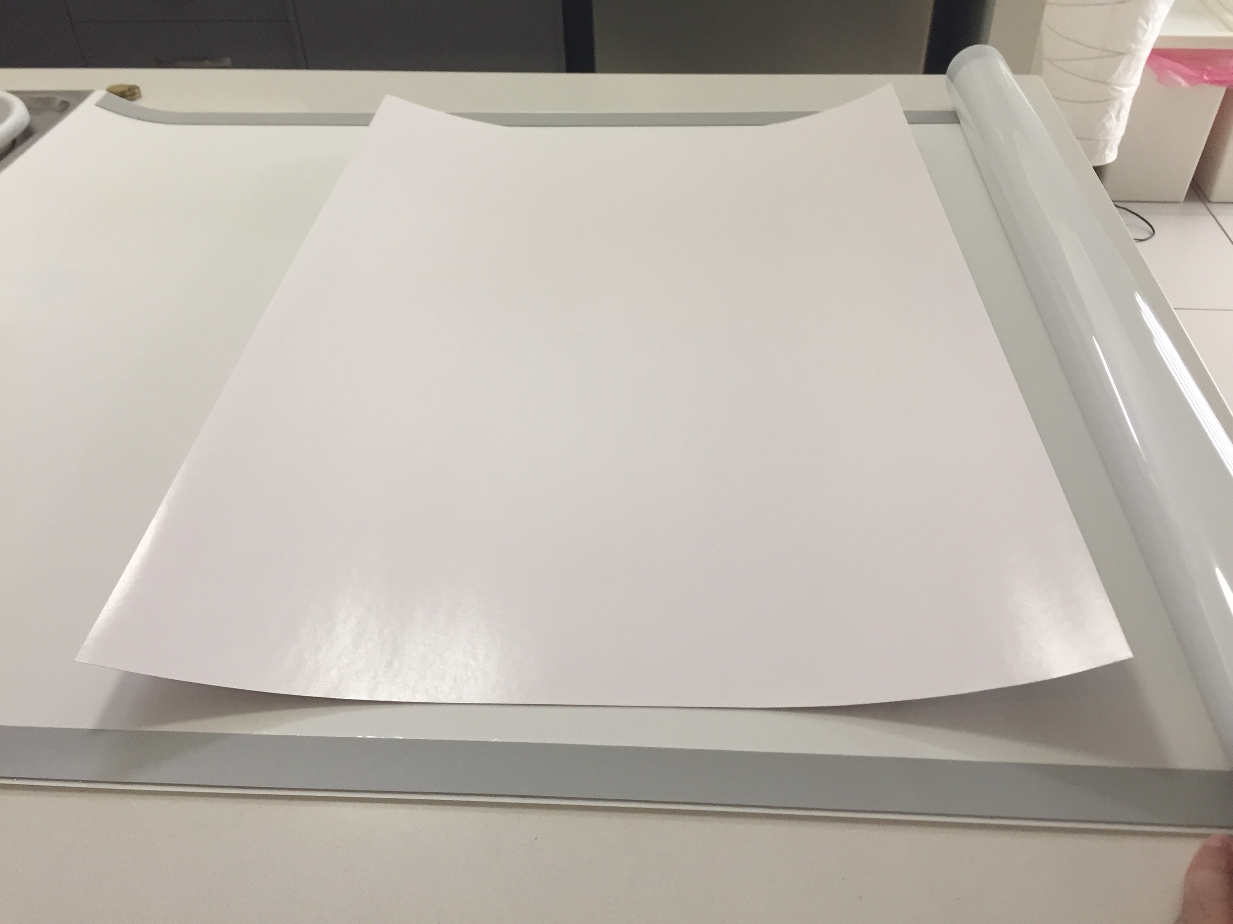The paper, immediately after being rolled, is now visibly very flat