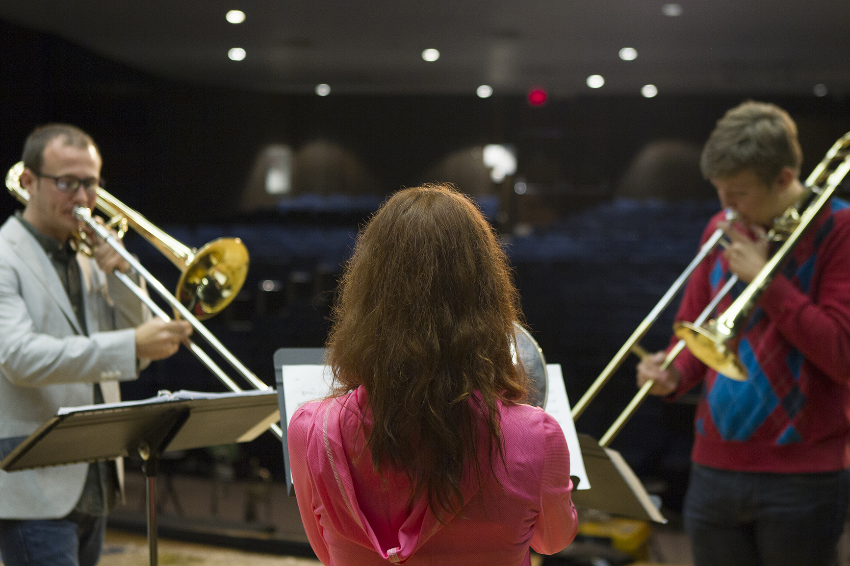Students Mikayla Murphy, center, and Brad Halloran, right, practice Monday during a rehearsal with Caleb Ketcham from visiting band Masterworks 6.