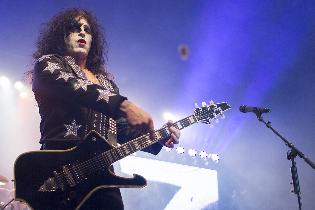 One of three rotating Hairball singers, dressed as Paul Stanley from KISS, throws a guitar pick into the crowd Friday January 15, 2016 at the Cam-plex Wyoming Center. Hairball, performing for over 15 years, returned to Gillette for their third time Friday.