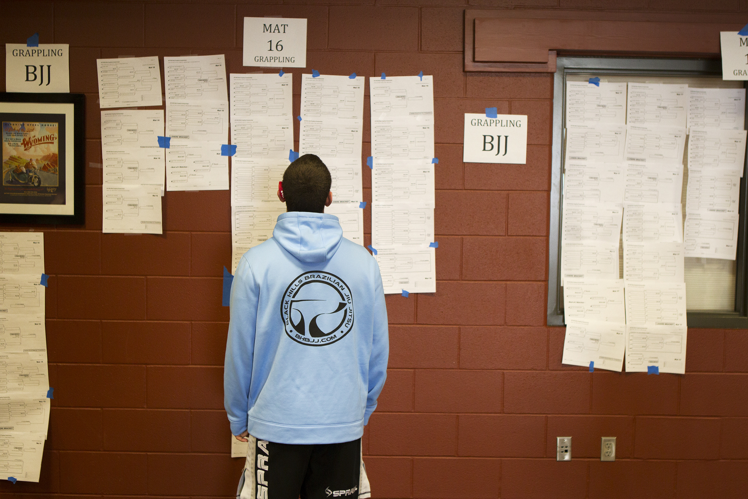 Justin Nelson from Rapid City, South Dakota, looks at the brackets Saturday for the grappling portion of the Wild West wrestling tournament at the Wyoming Center.