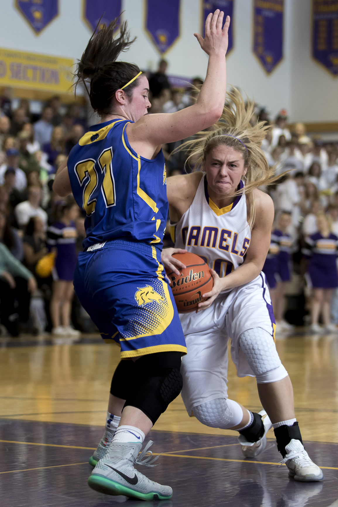 Gillette senior Jessie Geer drives past Sheridan's Robbie Ryan Friday night during the Camel's 63-51 win over the Broncs at CCHS North Campus.