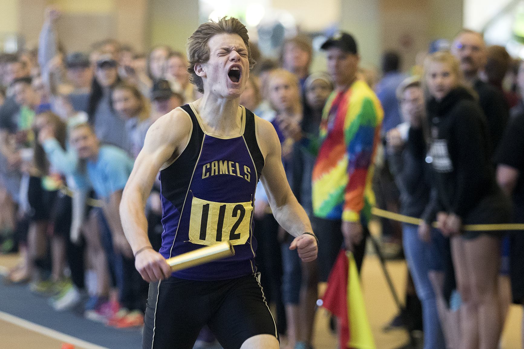 Gillette's Logan Myers celebrates as he crosses the finish line Saturday as the boys 4x400 team wins first place at the 4A Indoor Track Championships at the Recreation Center Field House.