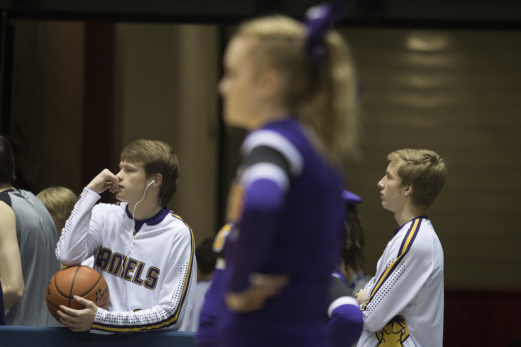 Gillette senior Dalton Holst, left, watches the Camel girls play in the semifinals of the girls 3A state basketball tournament Friday night at the Casper Event Center. Gillette beat Cheyenne East 58-46 and will play Natrona for the title Saturday evening.