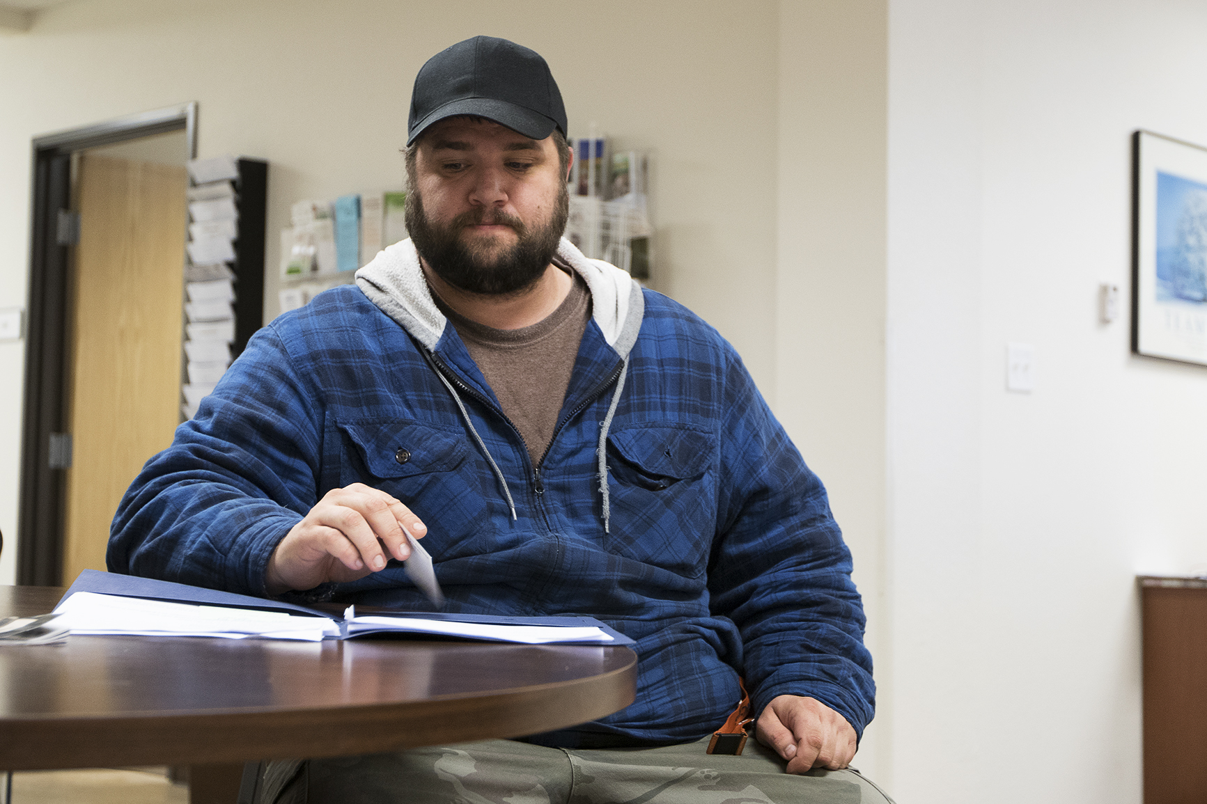 Kuillin Orcutt waits for a friend in the Wyoming Department of Workforce Services office Friday April 1, 2016 after getting started looking for work. Orcutt, who comes from a family of mine workers, was laid off Thursday from the North Antelope Rochelle mine along with more than 230 of his coworkers.