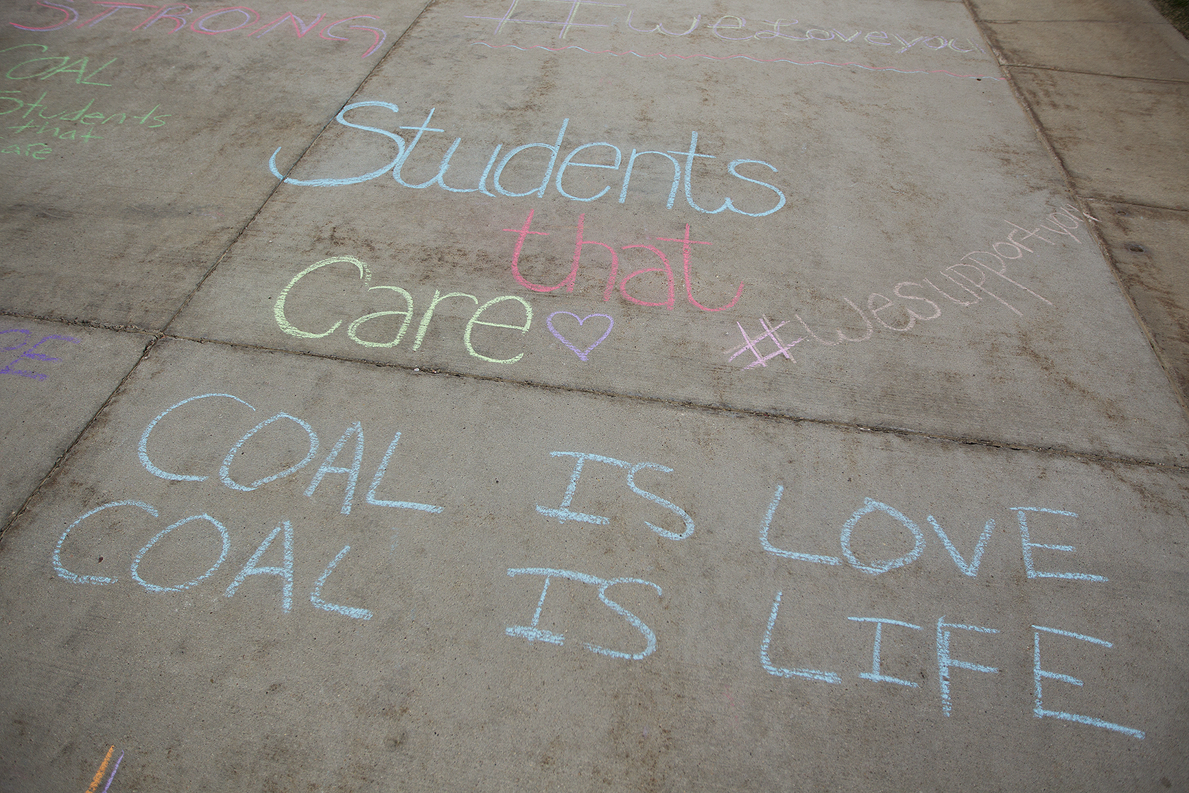 Supportive messages are written in chalk outside the Heritage Center before the Friends of Coal town hall meeting on Thursday April 14, 2016. Members of Friends of Coal, as well as miners and other coal industry representatives came to Gillette to speak about how to strengthen the perceptions around coal.