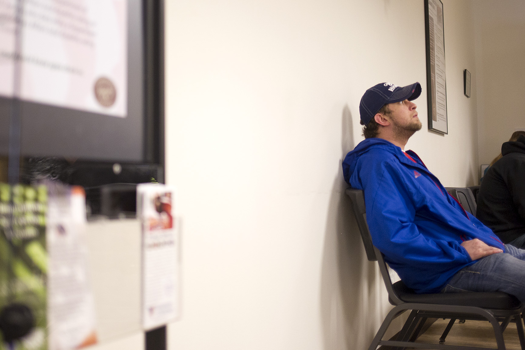 "Matt Johnson waits at the Wyoming Department of Workforce Services offices in Gillette on Thursday afternoon. Johnson was working for Big Horn Tire servicing the vehicles at Black Thunder Mine when he went into surgery to have a brain tumor removed. He expected to return to work in about two weeks when he got the call telling him he had been laid off. ""They let me go and I just got done with a brain surgery, so..."" he said, ""I'm kinda without a paddle."""