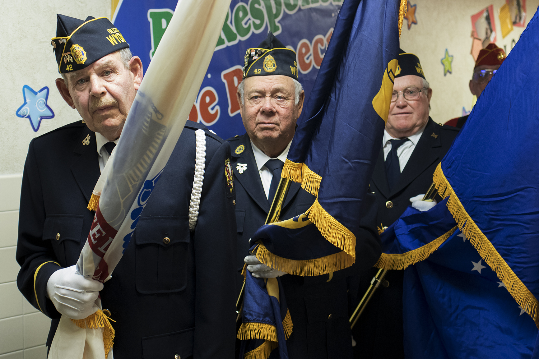 "US Navy veteran Bryan Pownall, center, carries a flag with fellow veterans as part of the honor guard for the ""Wyoming Veterans Welcome Home Day"" Tuesday afternoon at Rozet Elementary School."