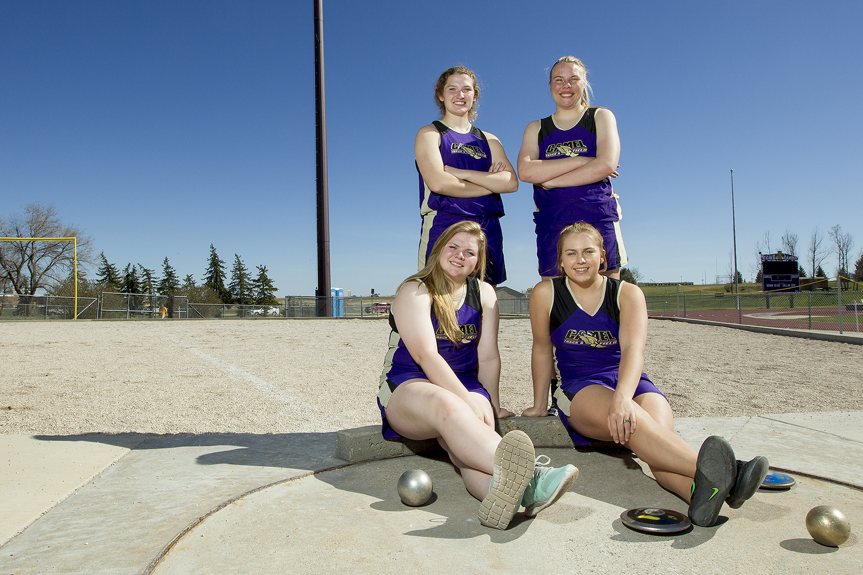 Gillette throwers Makayla Tucker, clockwise from back left, Jordan Fink, Taylor Smith and Shantell Gladson, photographed Thursday at the CCHS shot put pit, have all qualified for the state track meet in either the shot put or discuss, less than halfway through the season. Gladson won the indoor shot put title with a throw of 35 feet and 10.5 inches.