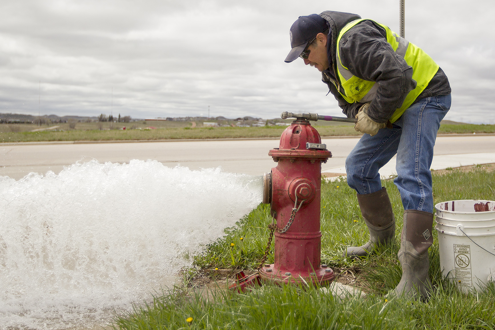 Scott Sorenson, foreman for the Gillette water division, opens a fire hydrant on Gurley Avenue Monday afternoon as the city crews begin flushing the city's water lines. The annual flushing of the water lines clears any sediment and debris that has settled in the pipes, and allows crews to check on water pressure and make sure the hydrants are working properly.