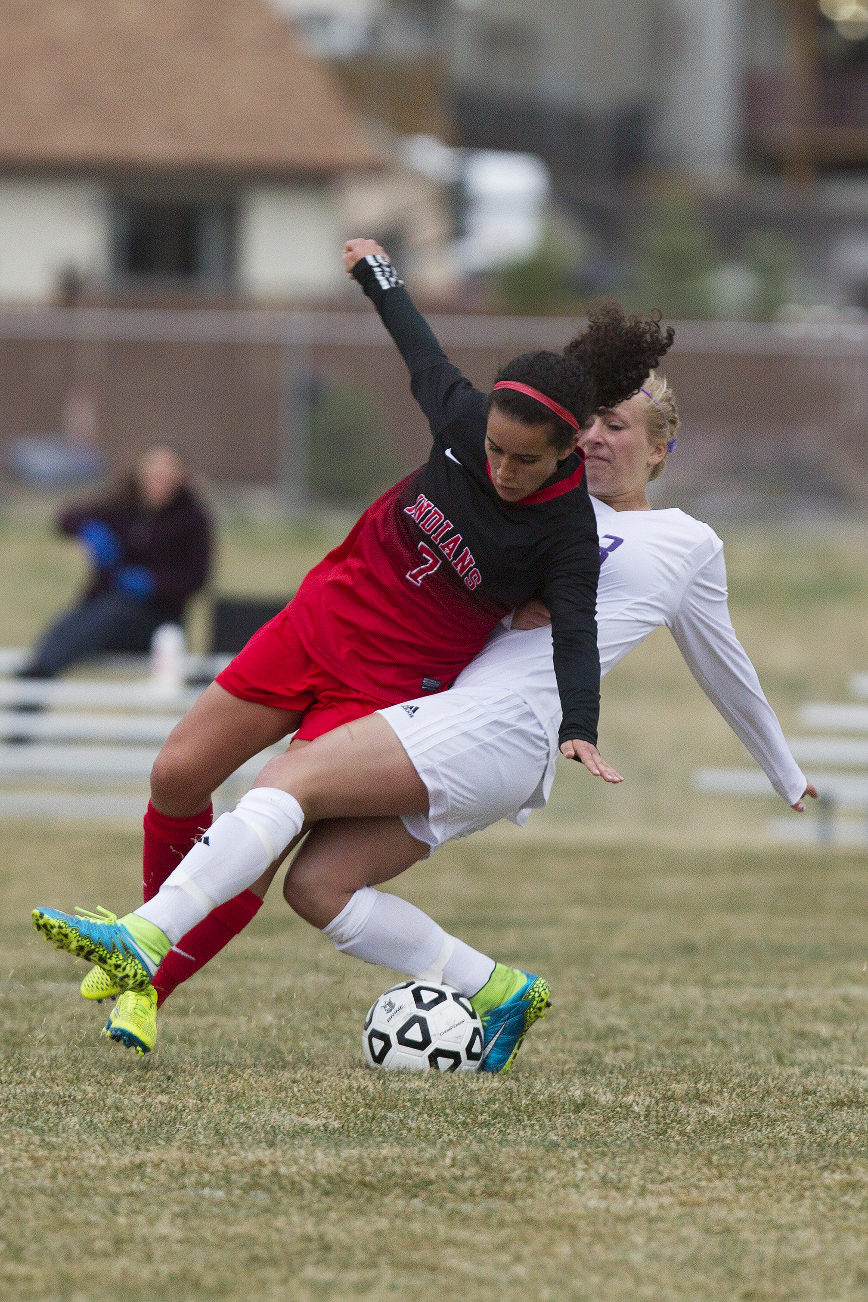 Gillette's Emma Jurewicz collides with Cheyenne Central's Alexa Becerra during the teams' 1-1 draw Friday night at CCHS South Campus. Jurewicz was shown two yellow cards during the game and was ejected during extra time.
