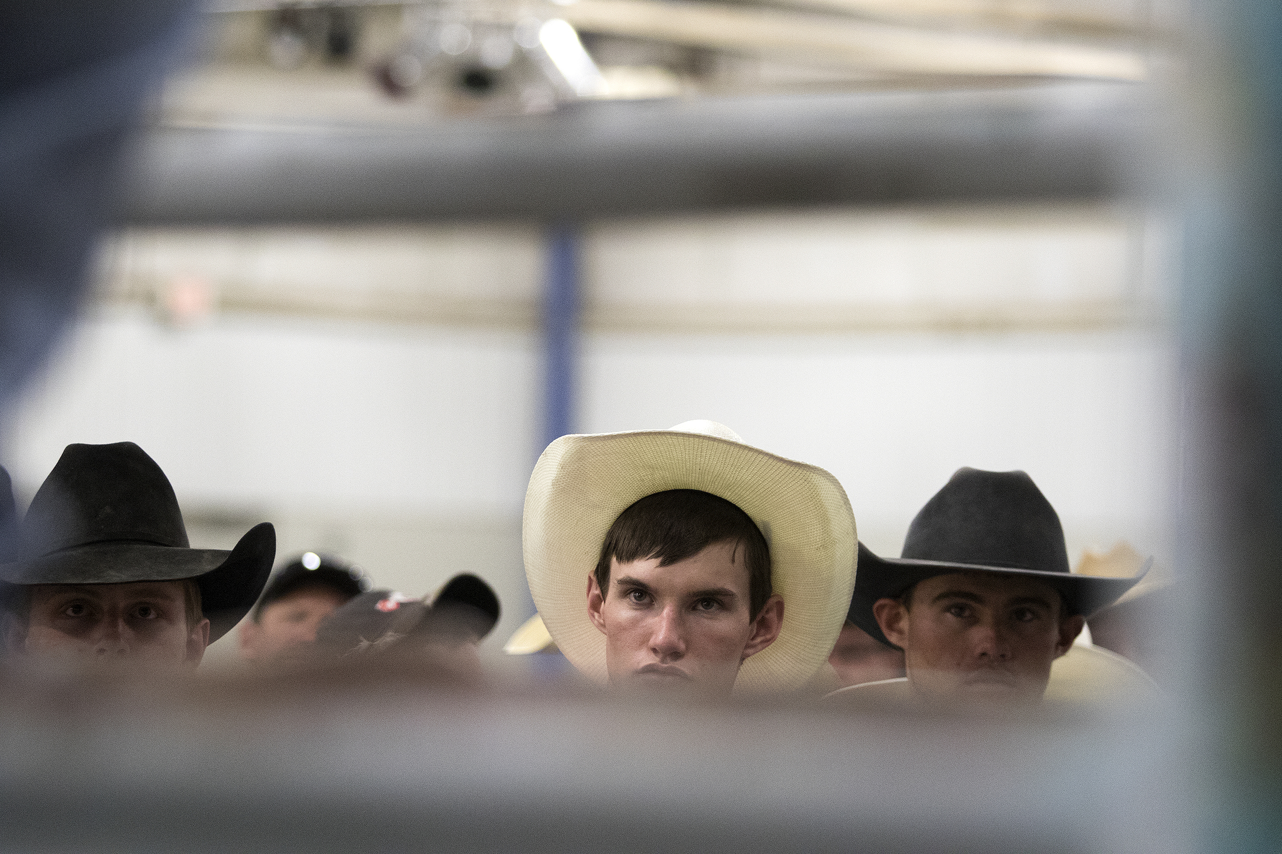 Roughstock competitors attend a mandatory training and safety session Saturday afternoon in Central Pavilion.
