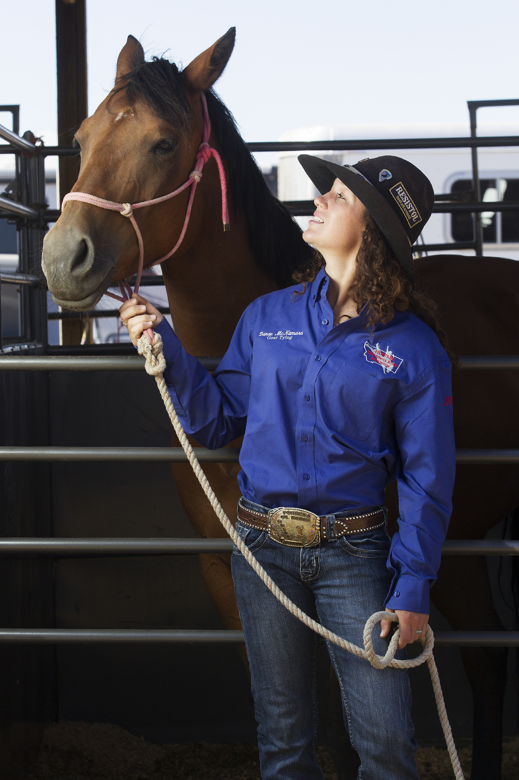 Danae McNamera stands with her horse Buckles in the stalls at Cam-plex Sunday morning.