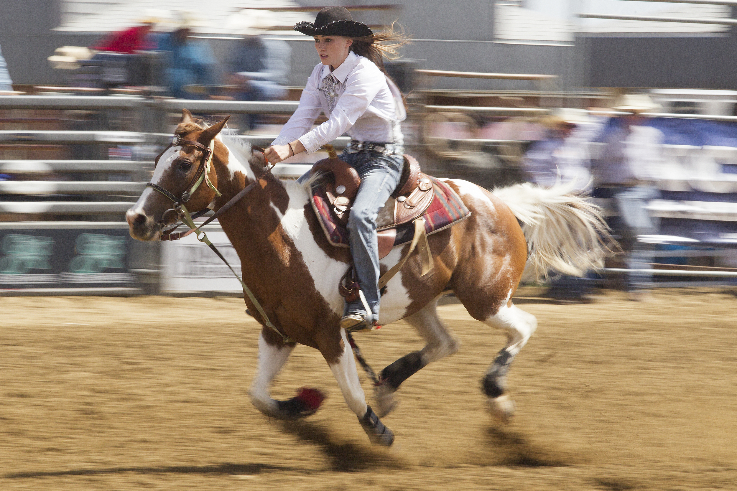 Destiny Shafer of Waddell, Aris., races through the pole bending course during the second performance of the National High School Finals Rodeo Monday morning at Morningside Park.