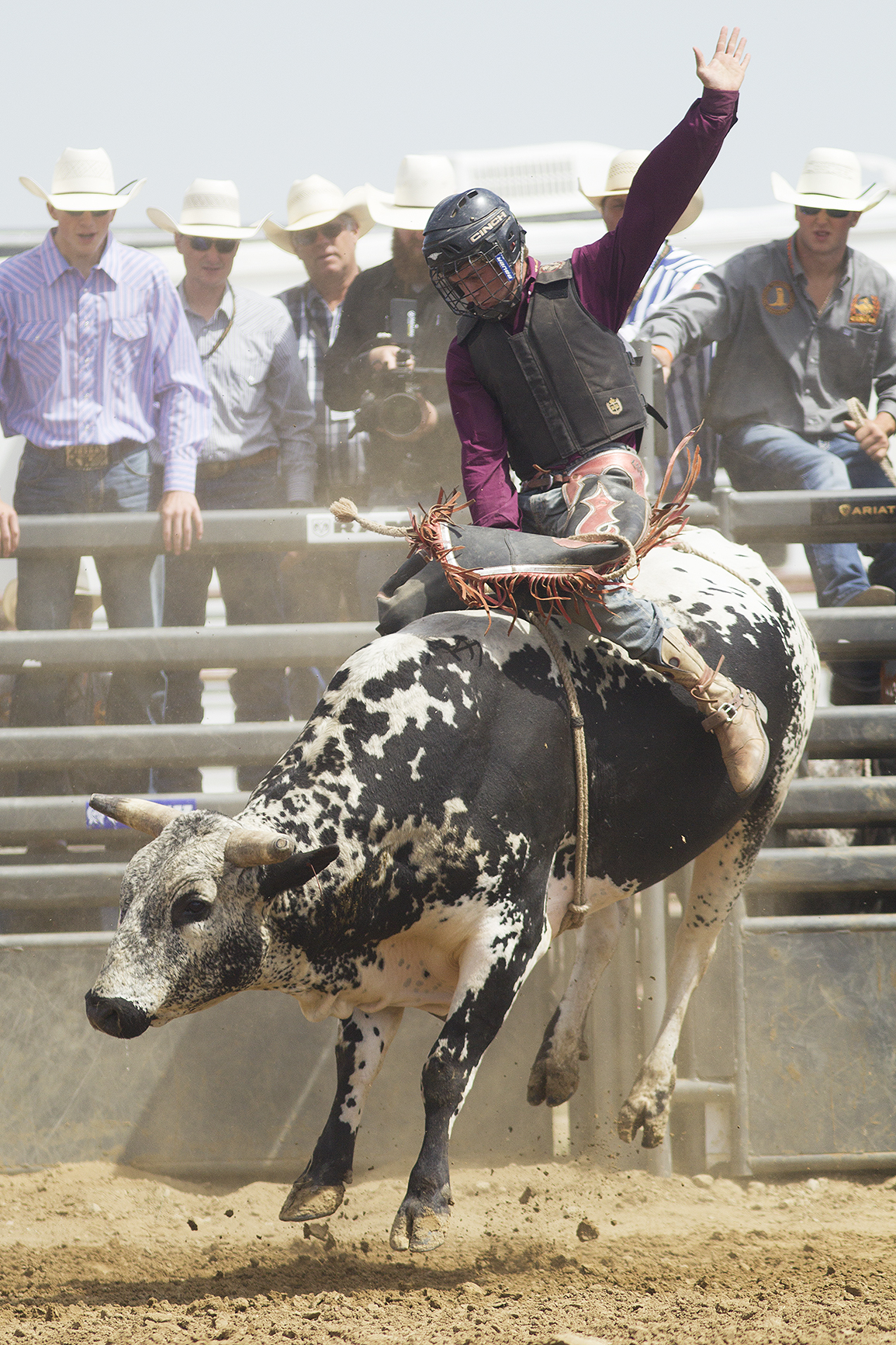 Bullrider Tanner Horner of Keokuk, Iowa, rides in the second performance of the National High School Finals Rodeo Monday morning at Morningside Park.